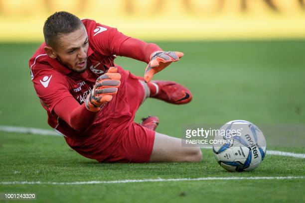 Sion's French goalkeeper Anthony Maisonnial stops the ball during a friendly football match between FC Sion and Inter Milan on July 18, 2018 at...
