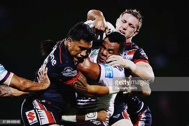 Siosaia Vave of the Sea Eagles is tackled by Albert Vete of the Warriors and Ryan Hoffman of the Warriors during the round six NRL match between the...