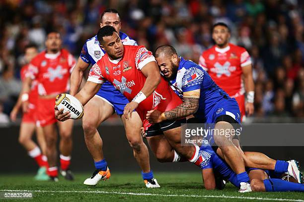 Siosala Vave of Tonga offloads the ball in a tackle during the International Rugby League Test match between Tonga and Samoa at Pirtek Stadium on May...