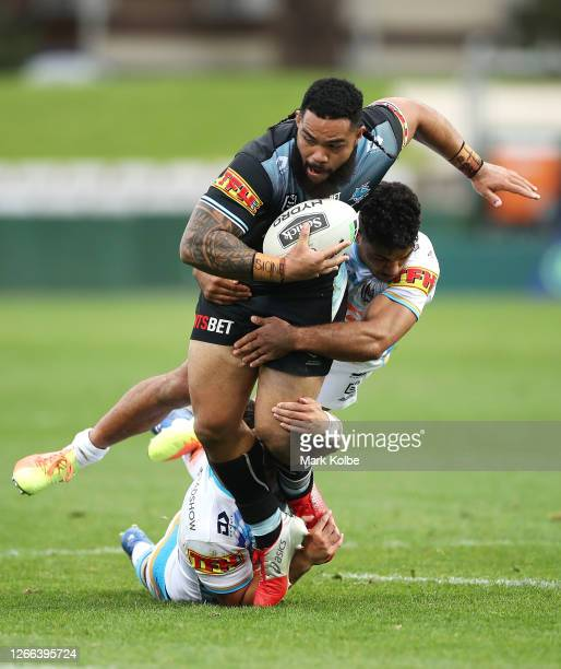 Siosifa Talakai of the Sharks is tackled during the round 14 NRL match between the Cronulla Sharks and the Gold Coast Titans at Netstrata Jubilee...