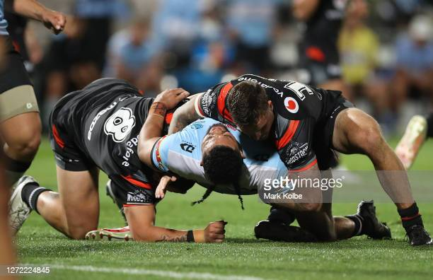 Siosifa Talakai of the Sharks reacts after hurting his knee in a tackle during the round 18 NRL match between the Cronulla Sharks and the New Zealand...
