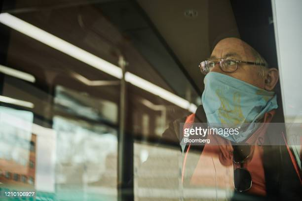 A Sioux Area Metro bus driver wears a protective mask while working in Sioux Falls South Dakota US on Wednesday April 15 2020 South Dakota Governor...