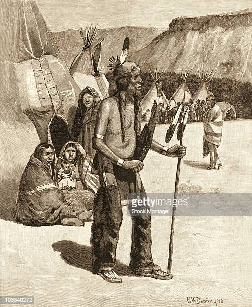A Sioux crier stands among the village teepees calling a war dance in this illustration by Edwin Willard Deming 1891