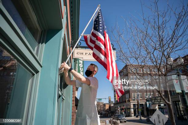 Sioux Falls, SD April 21: Chris Hanmer owner of Ch Patisserie packed the flag in front of his shop Tuesday morning . Chis has owned the shop for 7...