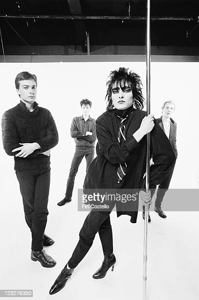 Siouxsie and the Banshees British punk band pose in a group studio portrait against a white background United Kingdom in April 1979