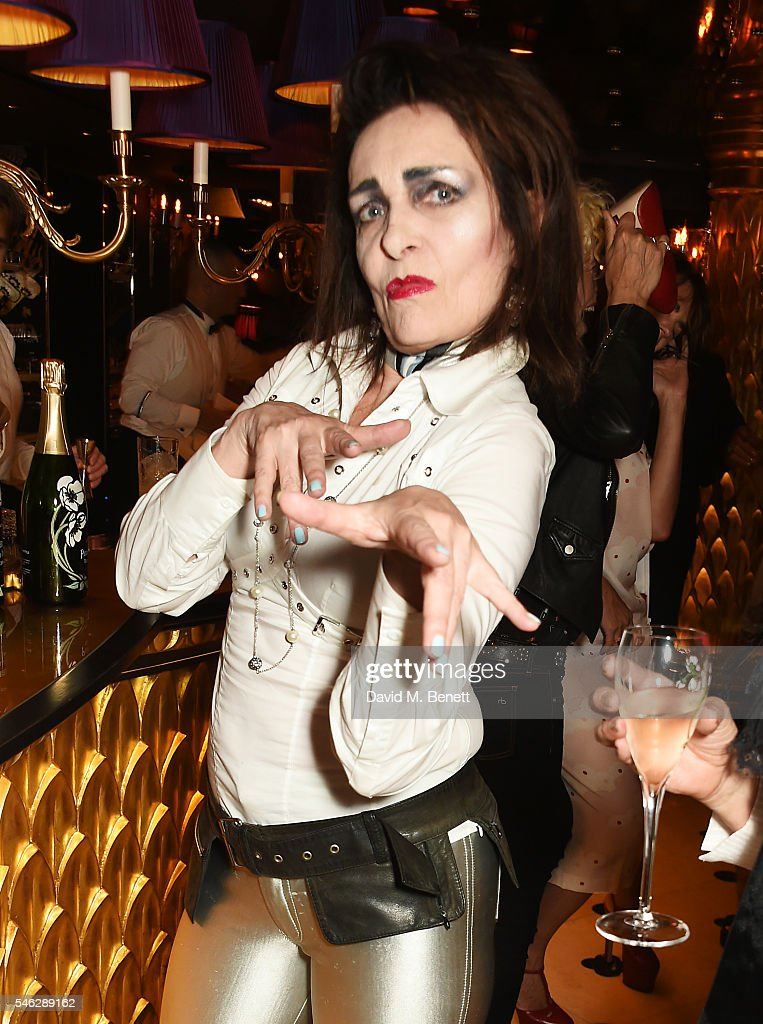 Siouxsie Sioux poses in Club Chinois at a party to celebrate Pam Hogg's honorary doctorate from Glasgow University in association with Perrier-Jouet on July 11, 2016 in London, England.