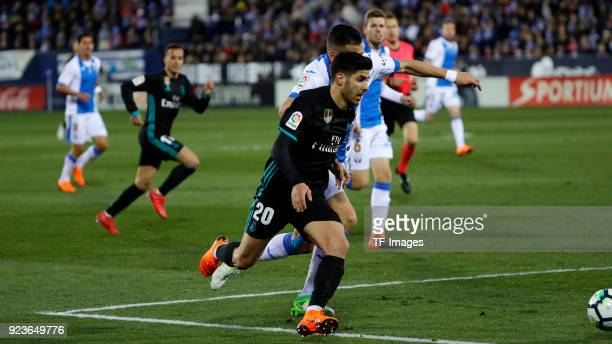 Siovas of Leganes and Marco Asensio of Real Madrid battle for the ball during the La Liga match between CD Leganes and Real Madrid at Estadio...