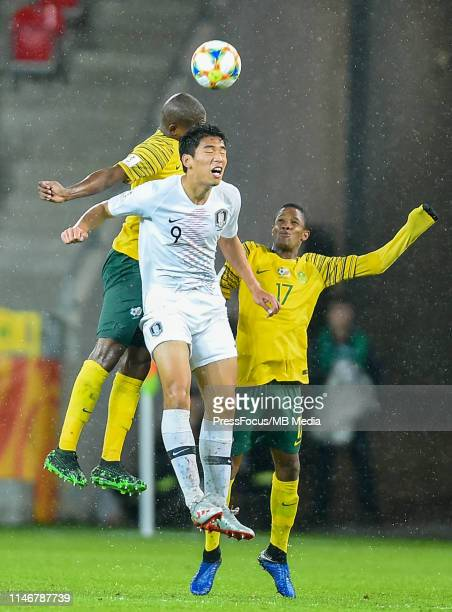 Sipheihle Mkhize and Luvuyo Phewa of South Africa competes with Sehun Oh of Korea Republic during the FIFA U20 World Cup match between South Africa...