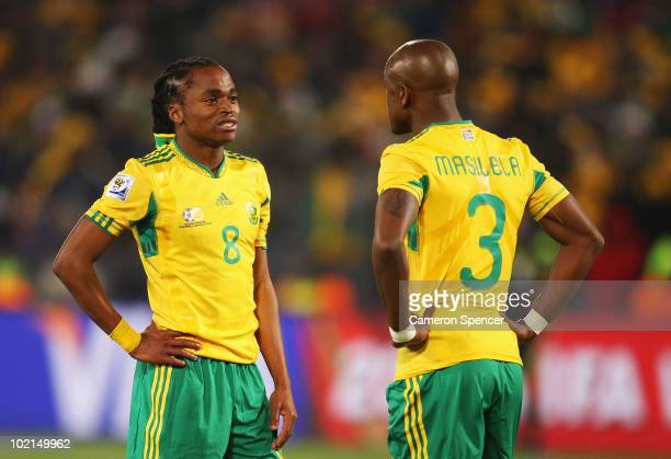 Siphiwe Tshabalala and Tsepo Masilela of South Africa are dejected after defeat in the 2010 FIFA World Cup South Africa Group A match between South...