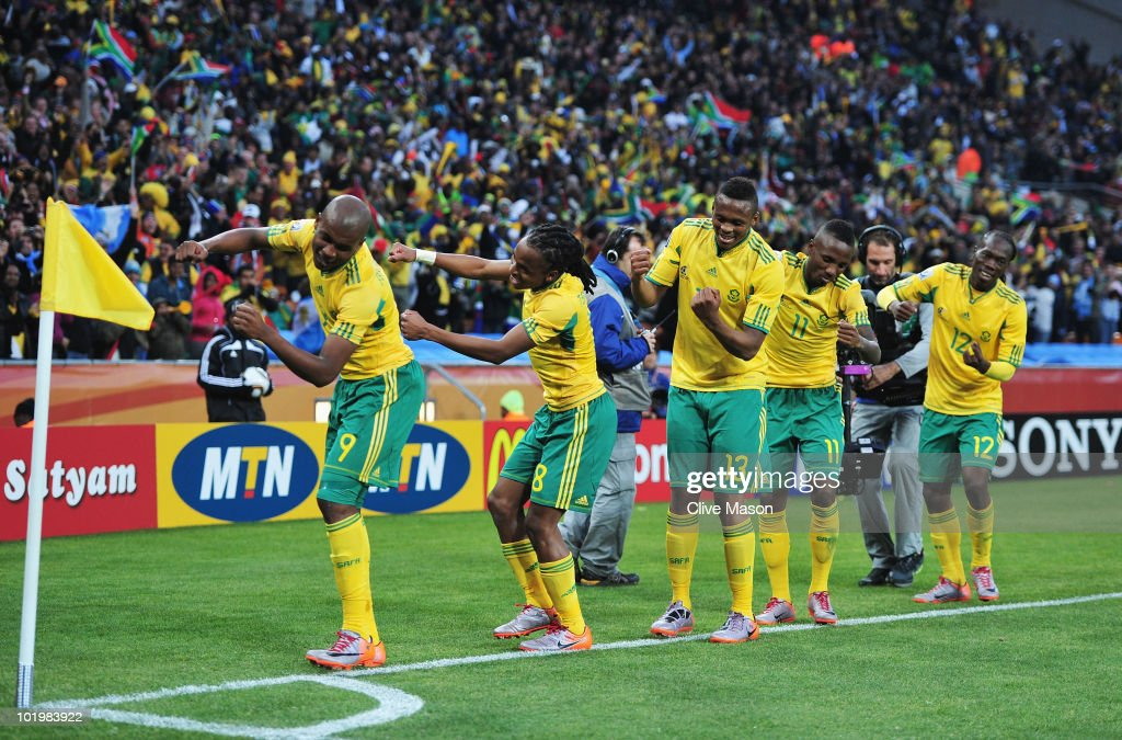 Siphiwe Tshabalala (C) of South Africa celebrates scoring the first goal with team mates during the 2010 FIFA World Cup South Africa Group A match between South Africa and Mexico at Soccer City Stadium on June 11, 2010 in Johannesburg, South Africa.