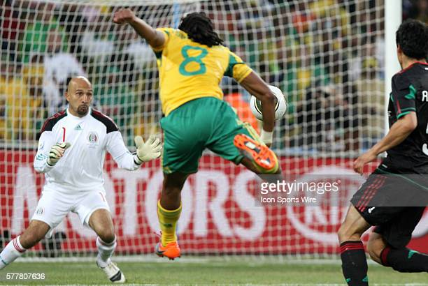 Siphiwe Tshabalala scores the first goal past Oscar Perez The South Africa National Team tied the Mexico National Team 11 at Soccer City Stadium in...