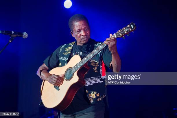 Sipho Mchunu who formerly made up the band Juluka with Johnny Clegg performs with Clegg at Grandwest Arena on June 30 2017 in Cape Town on the first...
