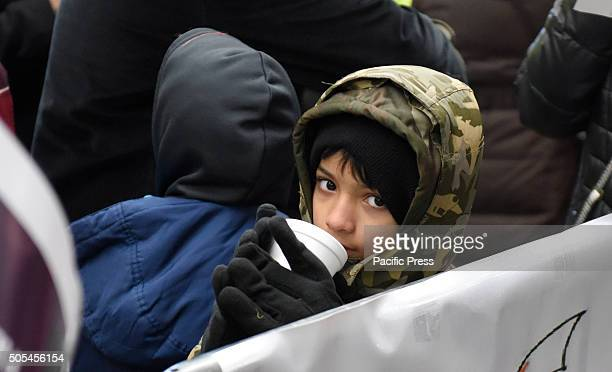 Sipping hot tea against the chill weather Hundreds of Muslims gathered in Times Square to protest against the Saudi government's execution of...