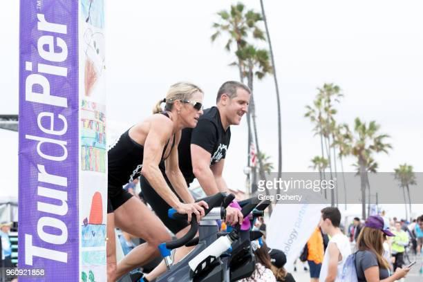 Sippy Brennan and Howard Beech ride at the 6th Annual Tour de Pier at Manhattan Beach Pier on May 20 2018 in Manhattan Beach California