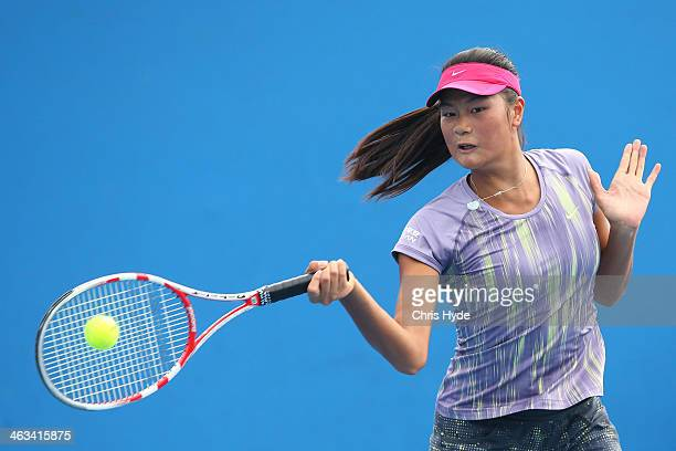 Siqi Cao of China plays a forehand in her first round junior girls' match against Anhelina Kalinina of the Ukraine during the 2014 Australian Open...