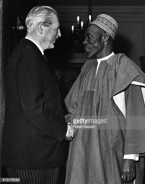Sir Abubakar Balewa the President of Nigeria shakes hands with the British Conservative Prime Minister Harold Macmillan 1962