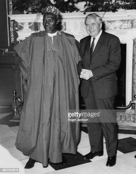 Sir Abubakar Tafawa Balewa the Prime Minister of Nigeria with British Prime Minister Harold Wilson at Marlborough House in London 17th June 1965 They...