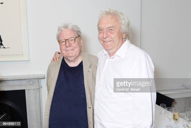 Sir Alan Parker and Roland Cowan attend the Bansky 'Greatest Hits 20022008' exhibition VIP preview at Lazinc on July 9 2018 in London England