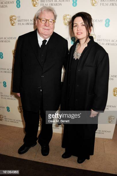 Sir Alan Parker and wife Lisa arrive at the EE British Academy Film Awards at the Royal Opera House on February 10 2013 in London England