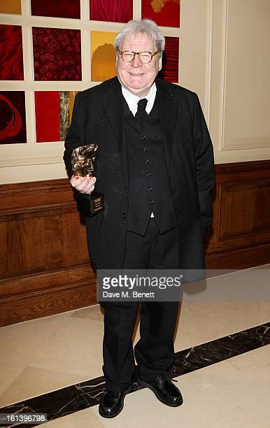 Sir Alan Parker arrives at the after party following the EE British Academy Film Awards at Grosvenor House on February 10 2013 in London England