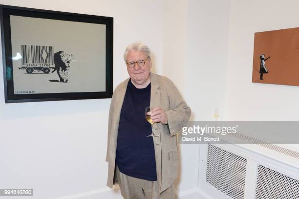 Sir Alan Parker attends the Bansky 'Greatest Hits 20022008' exhibition VIP preview at Lazinc on July 9 2018 in London England