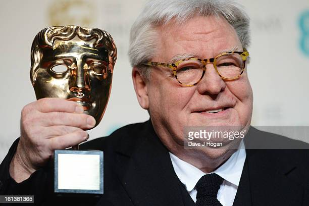 Sir Alan Parker poses with his BAFTA Fellowship Award in the press room at The EE British Academy Film Awards 2013 at The Royal Opera House on...
