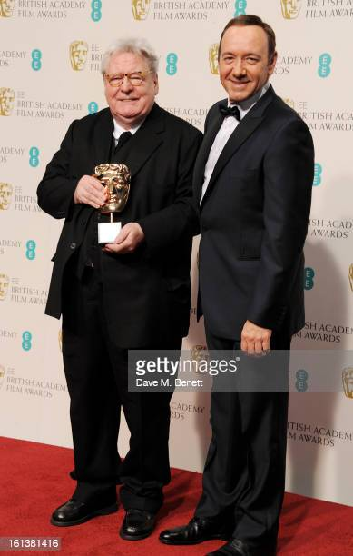 Sir Alan Parker winner of the BAFTA Fellowship and Kevin Spacey pose in the Press Room at the EE British Academy Film Awards at The Royal Opera House...