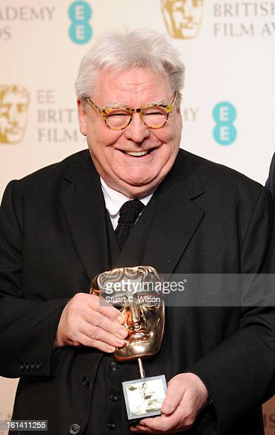 Sir Alan Parker winner of the Fellowship award poses in the press room at the EE British Academy Film Awards at The Royal Opera House on February 10...