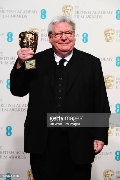 Sir Alan Parker with the award for Fellowship in the press room at the 2013 British Academy Film Awards at the Royal Opera House Bow Street London