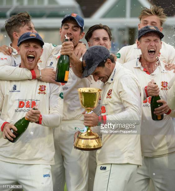 Sir Alastair Cook and his teammates celebrate after winning the County Championship after a draw in the County Championship Division One match...