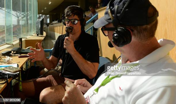 Sir Alastair Cook and Jonathan Agnew of the BBC during the first day of the second Test match between the West Indies and England at the Sir Vivian...