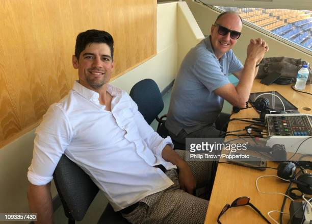 Sir Alastair Cook and Jonathan Agnew take a break during the third day of the second Test match between the West Indies and England at the Sir Vivian...