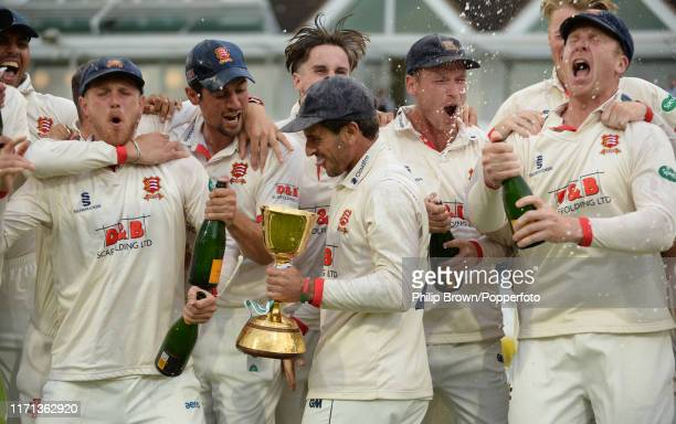 Sir Alastair Cook and Ryan ten Doeschate celebrate after winning the County Championship after a draw in the County Championship Division One match...