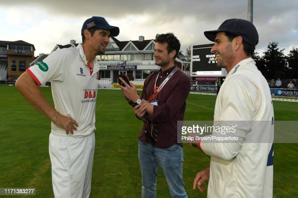 Sir Alastair Cook and Ryan ten Doeschate of Essex are interviewed by Henry Moeran of the BBC after Essex won the County Championship title after a...