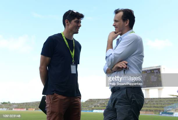 Sir Alastair Cook chats with Tom Harrison before a training session at the Sir Vivian Richards Stadium before the second Test match between the West...