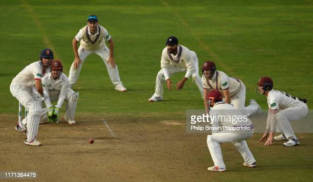 Sir Alastair Cook of Essex bats surrounded by Smoerset fielders during the fourth day of the County Championship Division One match between Somerset...