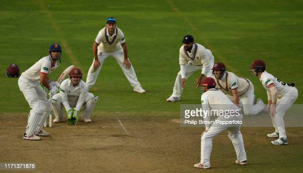 Sir Alastair Cook of Essex bats surrounded by Somerset fielders during the fourth day of the County Championship Division One match between Somerset...