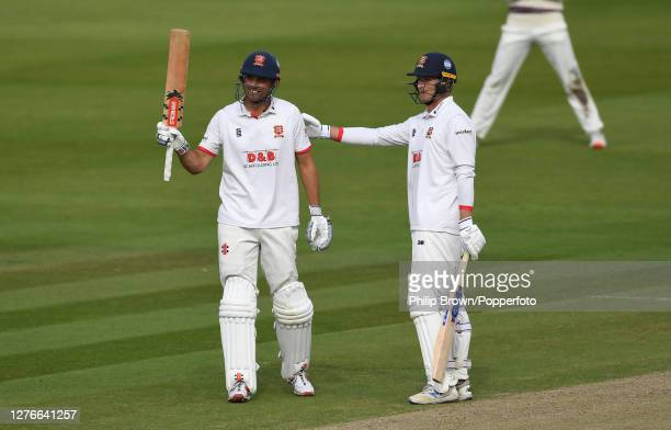 Sir Alastair Cook of Essex celebrates reaching his century with Tom Westley of Essex during the third day of the Bob Willis Trophy Final between...