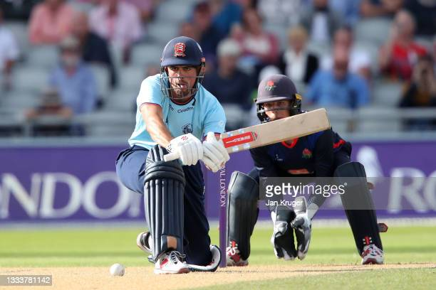 Sir Alastair Cook of Essex Eagles bats with George Lavelle of Lancashire looking on during the Royal London Cup match between Lancashire and Essex at...
