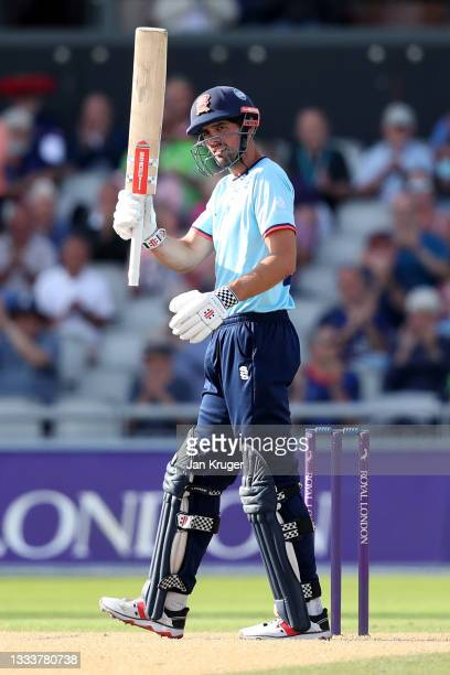Sir Alastair Cook of Essex Eagles celebrates a century during the Royal London Cup match between Lancashire and Essex at Emirates Old Trafford on...