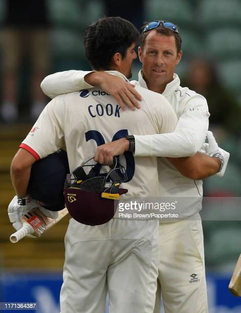 Sir Alastair Cook of Essex embraces Marcus Trescothick of Somerset after the draw in the County Championship Division One match between Somerset and...