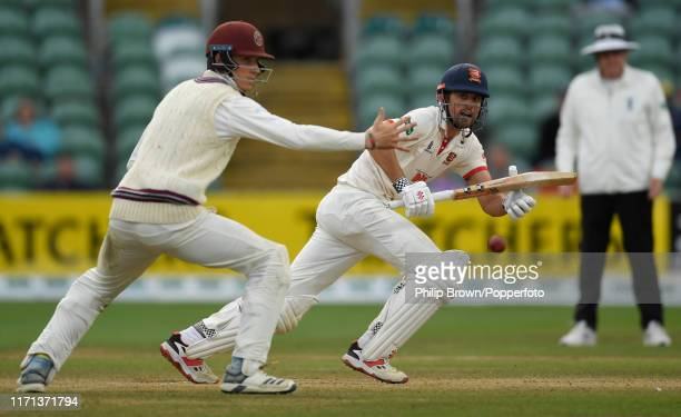 Sir Alastair Cook of Essex gets the ball past Tom Banton of Somerset during the fourth day of the County Championship Division One match between...
