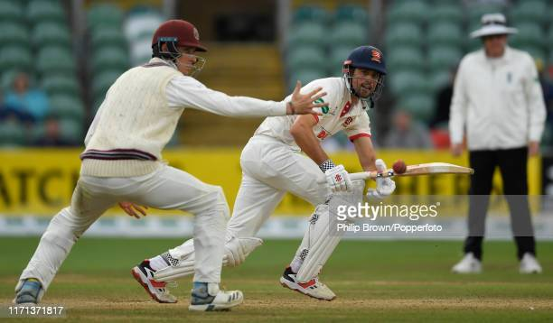 Sir Alastair Cook of Essex hits the ball past Tom Banton of Somerset during the County Championship Division One match between Somerset and Essex on...