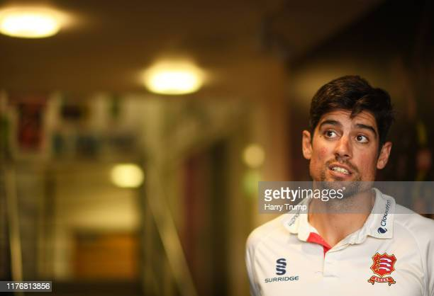 Sir Alastair Cook of Essex looks on as play is delayed during Day Two of the Specsavers County Championship Division One match between Somerset and...
