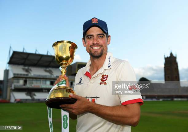 Sir Alastair Cook of Essex poses with the County Championship Trophy during Day Four of the Specsavers County Championship Division One match between...