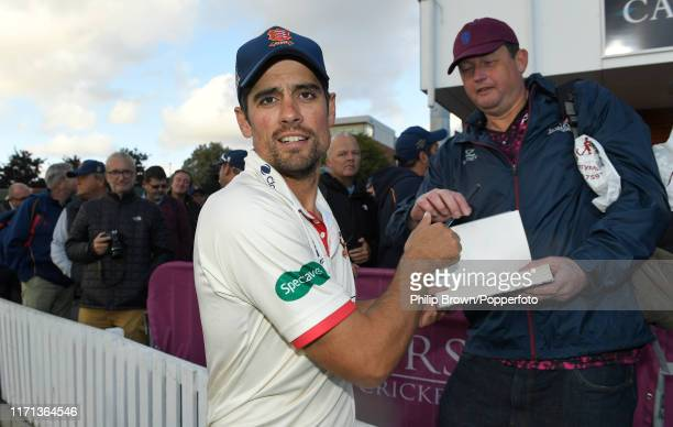 Sir Alastair Cook of Essex signs a book after the County Championship Division One match between Somerset and Essex on September 26 2019 in Taunton...