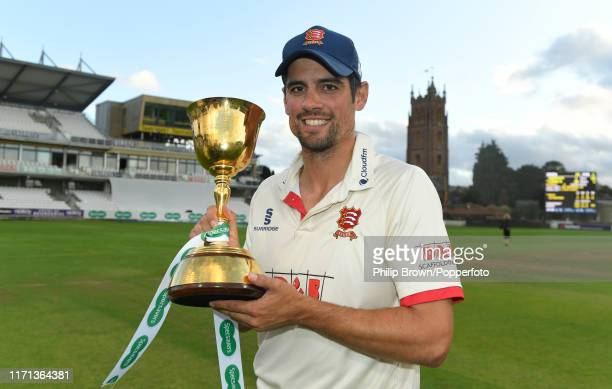 Sir Alastair Cook with the trophy after Essex won the County Championship title after a draw in the County Championship Division One match between...