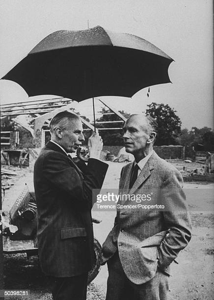 Sir Alec DouglasHome Conservative Party candidate for Prime Minister talking to unidentified man