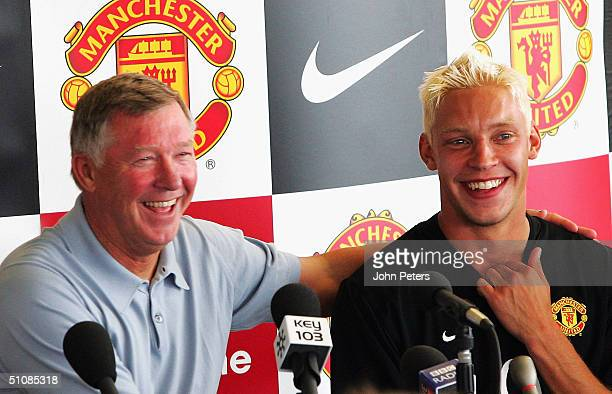 Sir Alex Ferguson and Alan Smith of Manchester United share a joke during a press conference to unveil United's new signings Alan Smith and Liam...