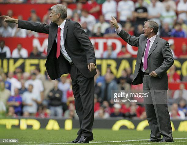 Sir Alex Ferguson and Arsene Wenger of Arsenal shout instructions from the sidelies during the Barclays Premiership match between Manchester United...